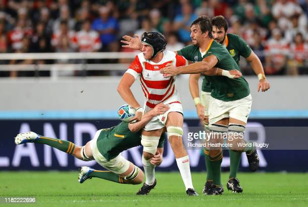 James Moore of Japan is tackled by Lodewyk De Jager and PieterSteph Du Toit of South Africa during the Rugby World Cup 2019 Quarter Final match...
