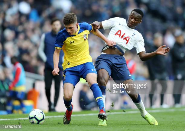 James Morris of Southampton is challenged by Jubril Okedina of Tottenham during the U18 Premier League between Tottenham Hotspur and Southampton at...