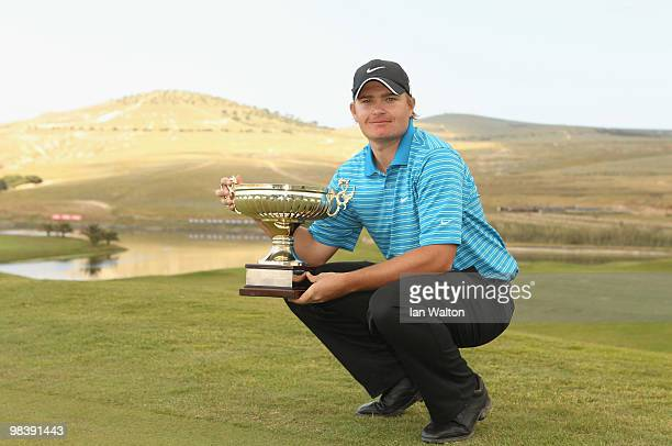 James Morrison of England celebrates with the trophy after winning the final round of the Madeira Islands Open at the Porto Santo golf club on April...