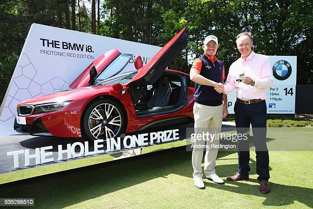 James Morrison of England poses with Dr Ian Robertson Member of the Board BMW AG Sales and his new BMW i8 car after his holeinone on the 14th during...