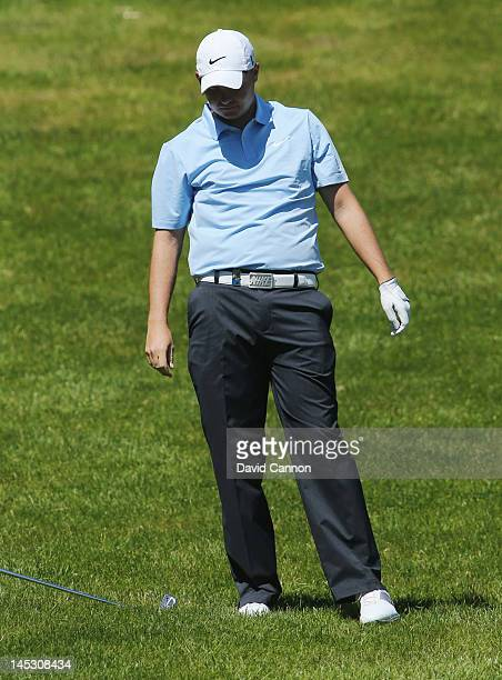 James Morrison of England reacts to a wayward shot on the fourth hole during the third round of the BMW PGA Championship on the West Course at...