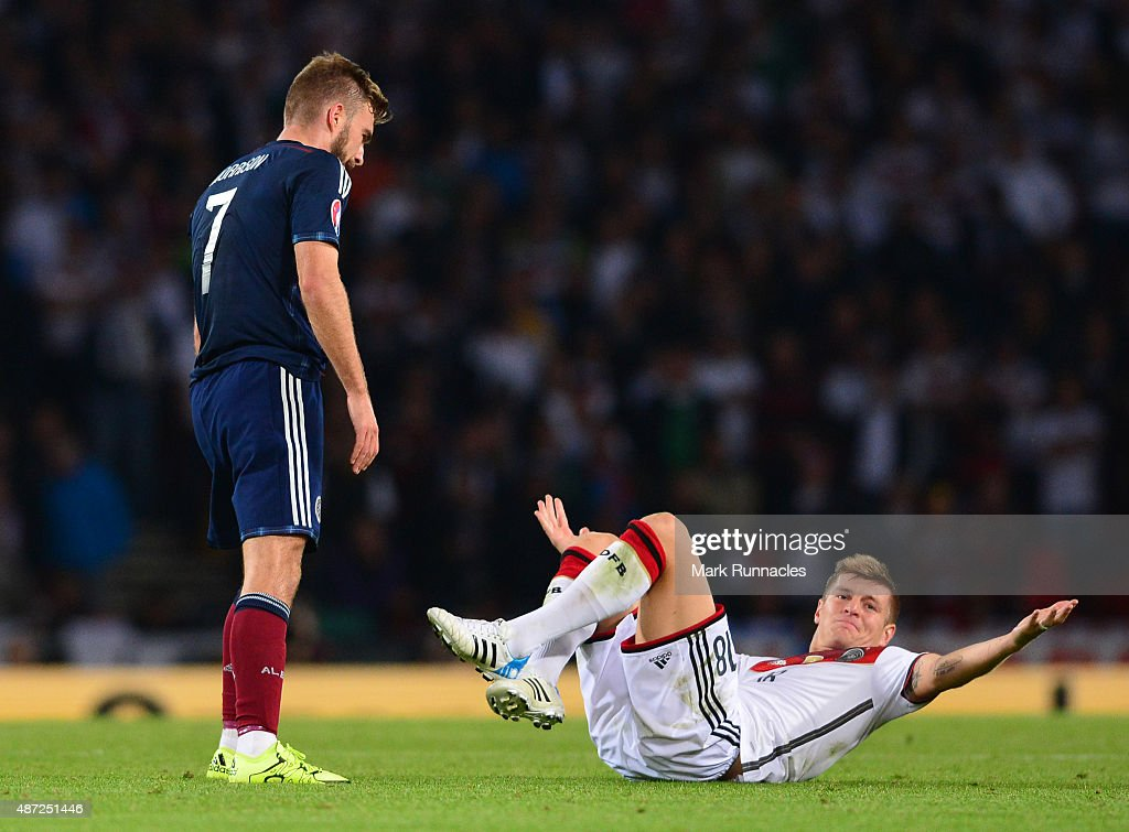 James Morrison of Scotland and Toni Kroos of Germany collide during the EURO 2016 Qualifier between Scotland and Germany at Hamden Park on September 7, 2015 in Glasgow, Scotland.