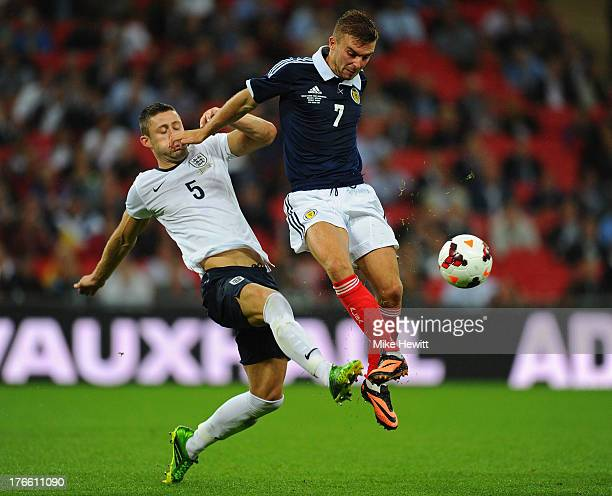 James Morrison of Scotland is challenged by Gary Cahill of England during the International Friendly match between England and Scotland at Wembley...