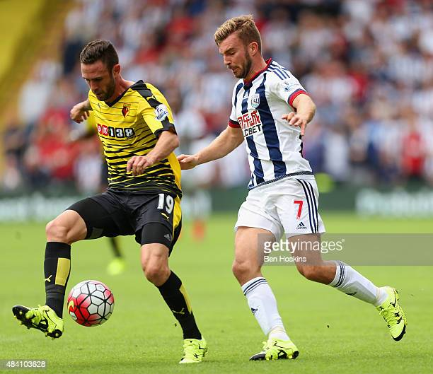 James Morrison of West Bromwich Albion and Miguel Layun of Watford compete for the ball during the Barclays Premier League match between Watford and...