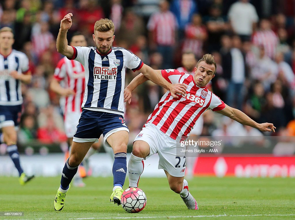 James Morrison of West Bromwich Albion and Xherdan Shaqiri of Stoke City during the Barclays Premier League match between West Bromwich Albion and Stoke City on August 29, 2015 in Stoke on Trent, United Kingdom.