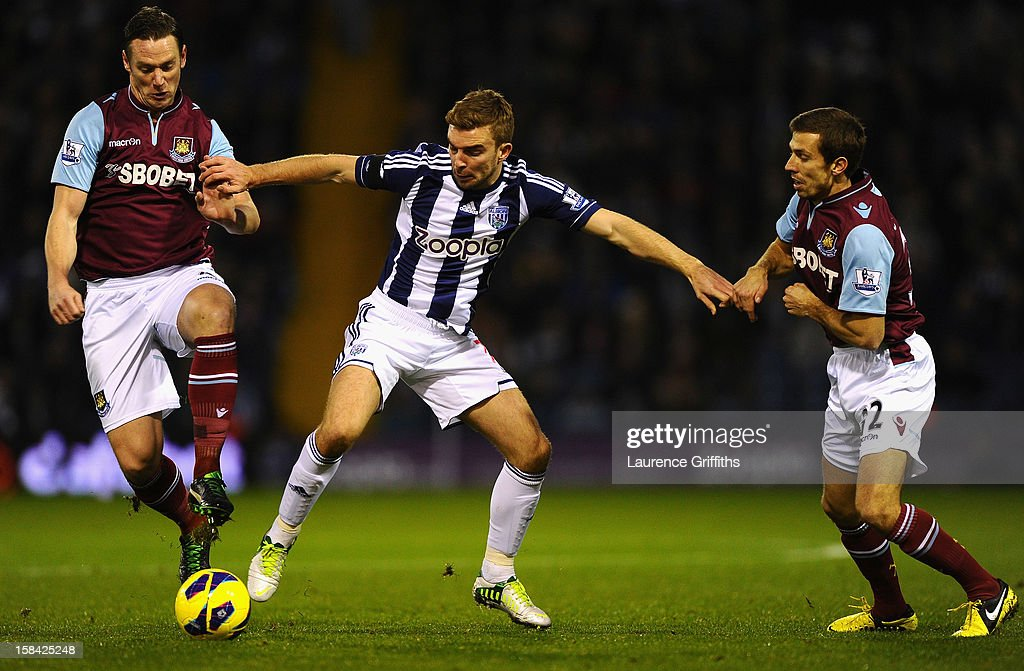 James Morrison of West Bromwich Albion battles with Kevin Nolan and Gary O'Neil of West Ham United during the Barclays Premiership match between West Bromwich Albion and West Ham United at The Hawthorns on December 16, 2012 in West Bromwich, England.