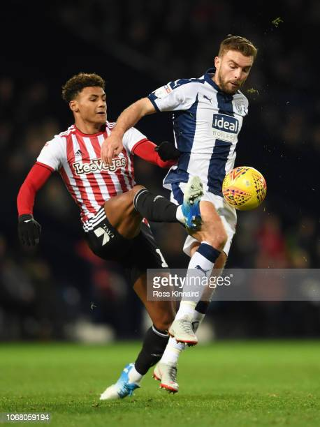 James Morrison of West Bromwich Albion battles with Ollie Watkins of Brentford during the Sky Bet Championship match between West Bromwich Albion and...