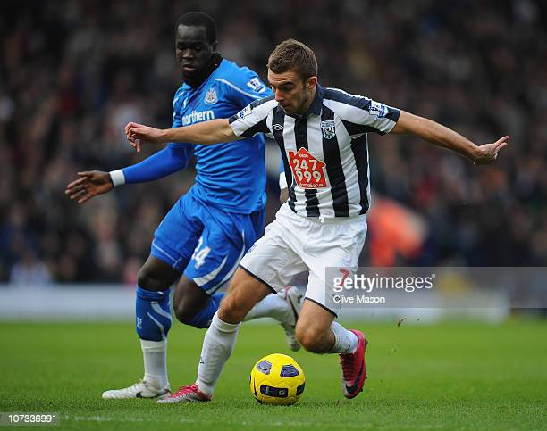James Morrison of West Bromwich Albion holds off a challenge from Cheik Tiote of Newcastle United during the Barclays Premier League match between...