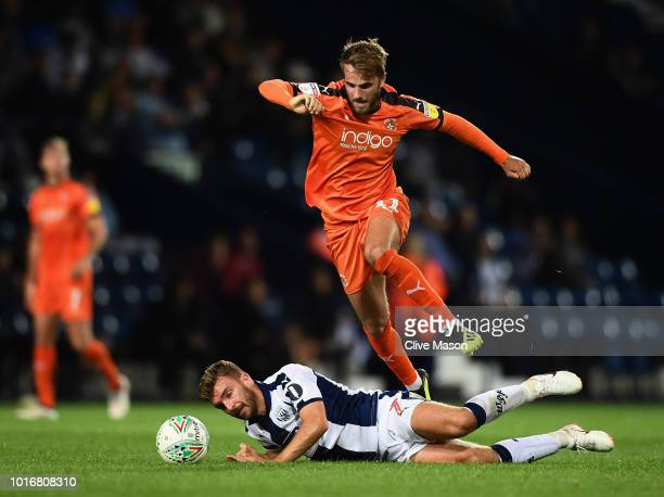 James Morrison of West Bromwich Albion is challenged by Andrew Shinnie of Luton Town during the Carabao Cup First Round match between West Bromwich...