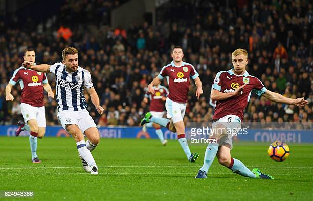 James Morrison of West Bromwich Albion shoots past Ben Mee of Burnley as he scores their second goal during the Premier League match between West...