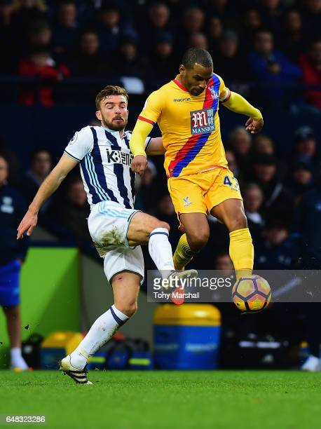 James Morrison of West Bromwich Albion tackles Jason Puncheon of Crystal Palace during the Premier League match between West Bromwich Albion and...