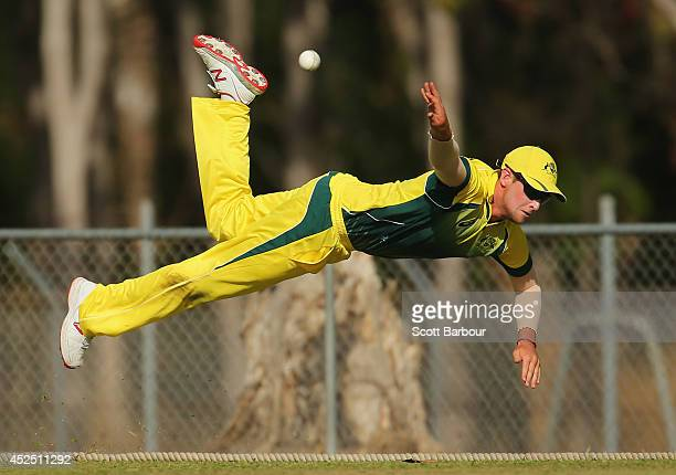 James Muirhead of the Cricket Australia National Performance Squad unsuccessfully attempts to throw the ball to a teammate after taking a catch on...
