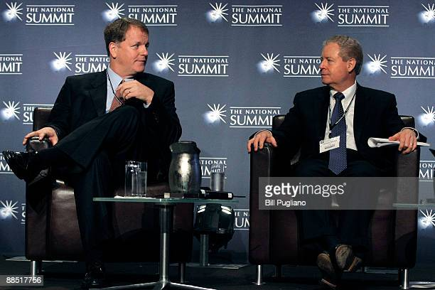 James Mulva Chairman and CEO of ConocoPhilips Company and W Douglas Parker Chairman and CEO of US Airways Group sit on the panel at an Energy Town...