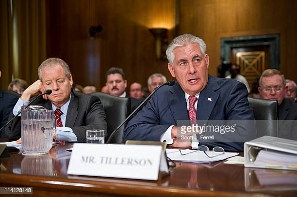 James Mulva chairman and CEO of ConocoPhillips and Rex Tillerson chairman and CEO of Exxon Mobil Corp during the Senate Finance hearing on oil and...