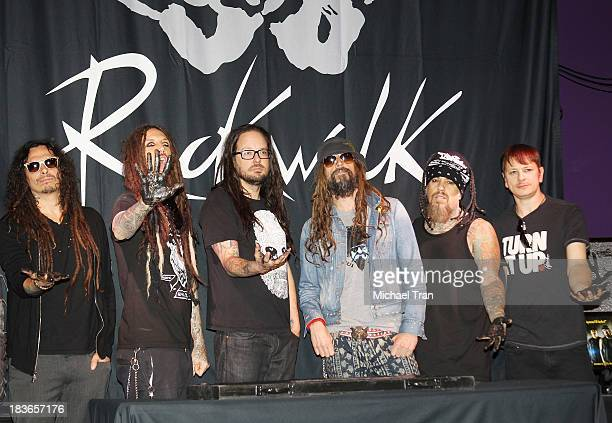 James 'Munky' Shaffer Brian 'Head' Welch Jonathan Davis Rob Zombie Reginald 'Fieldy' Arvizu Ray Luzier of KORN attend their induction ceremony into...