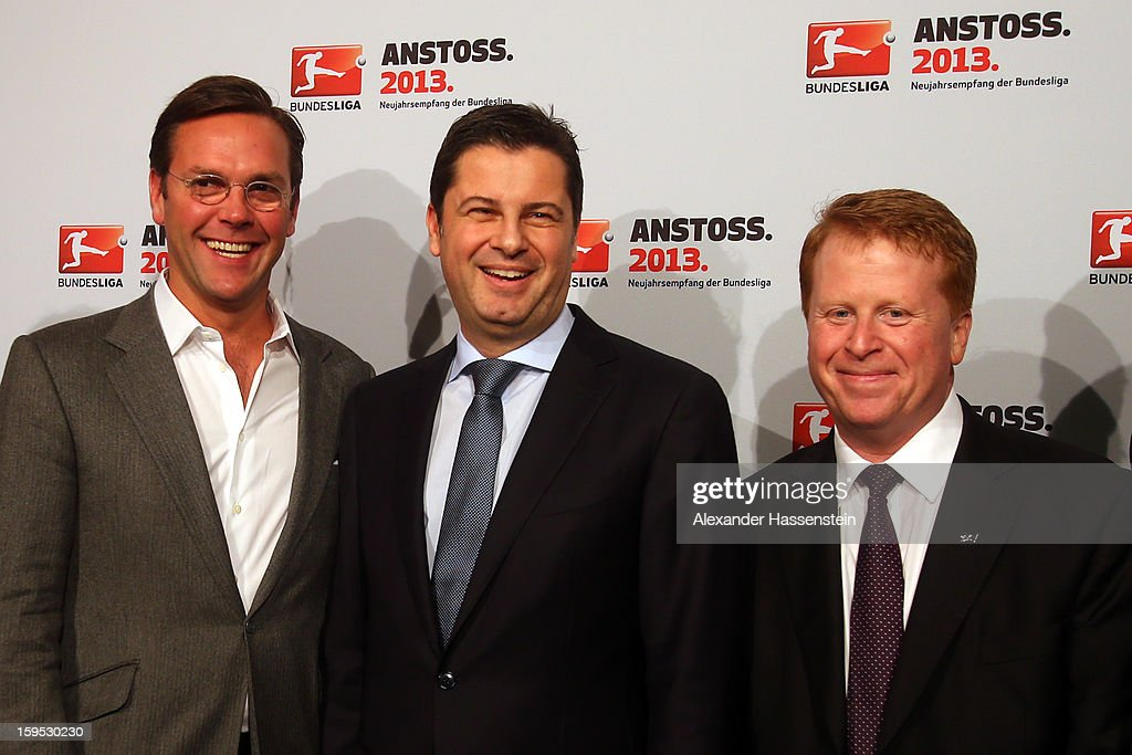 James Murdoch (L), CEO News Corporation Europe and Asia, Christian Seifert (C), chairman of business for DFL and Brian Sullivan, chairman of SKY Germany pose during the DFL new year's reception at the Thurn und Taxis Palais on January 15, 2013 in Frankfurt am Main, Germany.