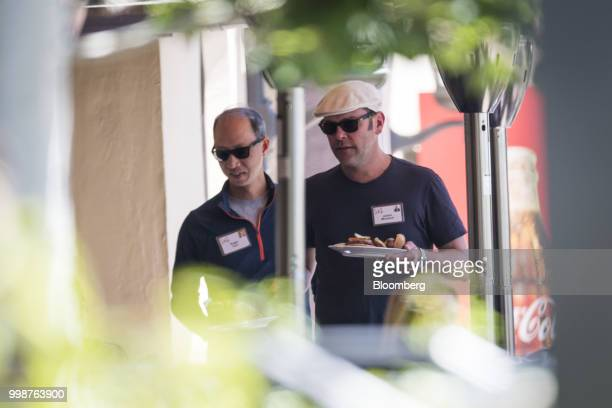 James Murdoch chief executive officer of TwentyFirst Century Fox Inc right and Roger Kuo senior vice president of Dodge and Cox Funds walk to lunch...