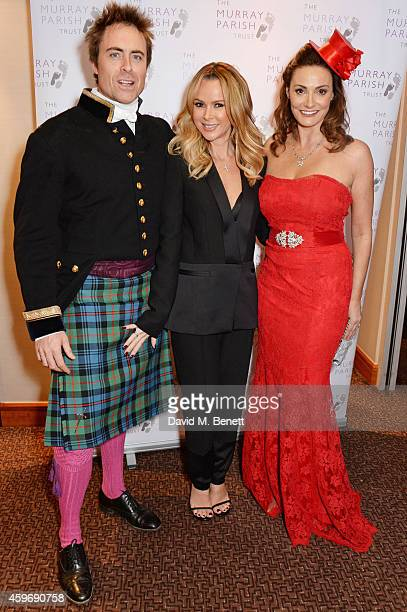 James Murray Amanda Holden and Sarah Parish attend 'The Odd Ball' 'hosted by The Murray Parish Trust at The Royal Garden Hotel on November 28 2014 in...