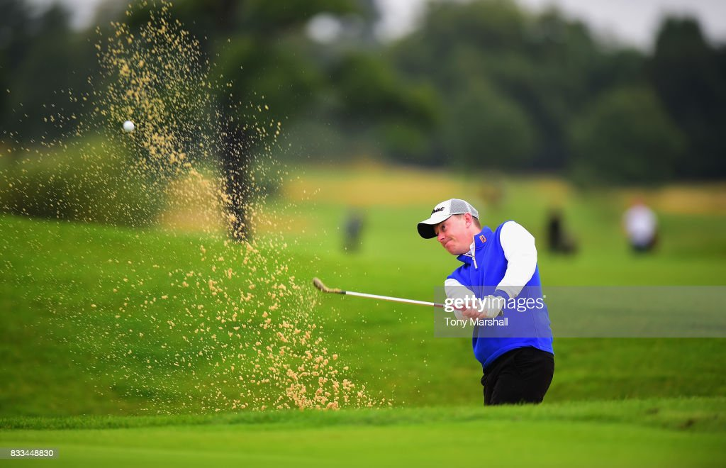 James Mynott of St Ives Golf Club plays out of a bunker on to the 1st green during the Golfbreaks.com PGA Fourball Championship - Day 2 at Whittlebury Park Golf & Country Club on August 17, 2017 in Towcester, England.