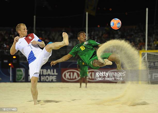 James Naka of Solomon Islands is challenged by Patrick Ax of Netherlands during the FIFA Beach Soccer World Cup Tahiti 2013 Group B match between...