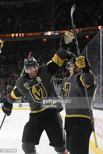 James Neal and Jonathan Marchessault of the Vegas Golden Knights celebrate after Marchessault scored a secondperiod powerplay goal against the Tampa...
