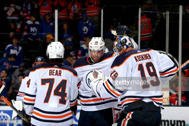 James Neal and Mikko Koskinen of the Edmonton Oilers celebrate their teams 52 win over the New York Islanders during the third period at NYCB Live's...