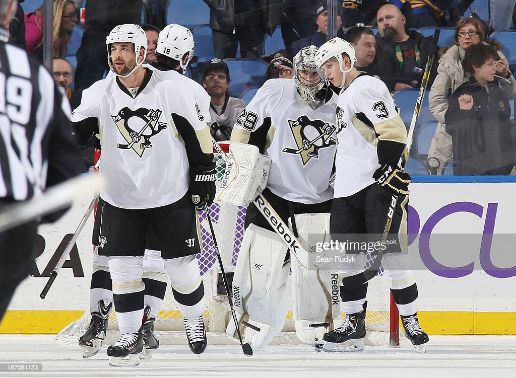 James Neal #18, Marc-Andre Fleury #29 and Olli Maatta #3 of the Pittsburgh Penguins celebrate a 5-1 win over the Buffalo Sabres at First Niagara Center on February 5, 2014 in Buffalo, New York.