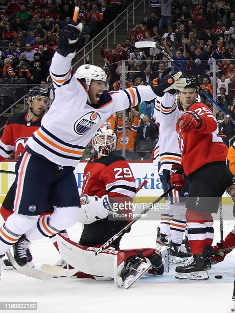 James Neal of the Edmonton Oilers celebrates the game tying goal by Connor McDavid at 18:54 of the third period against the New Jersey Devils at the...