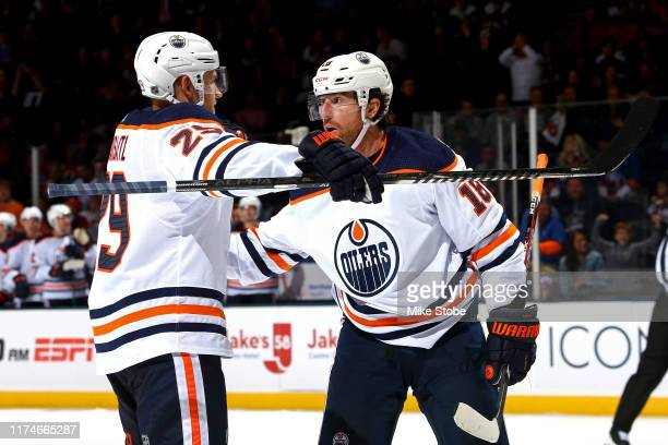 James Neal of the Edmonton Oilers is congratulated by his teammate Leon Draisaitl after scoring his third goal of the game against the New York...