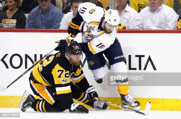 James Neal of the Nashville Predators and Patric Hornqvist of the Pittsburgh Penguins collide at the boards during the first period of Game Two of...