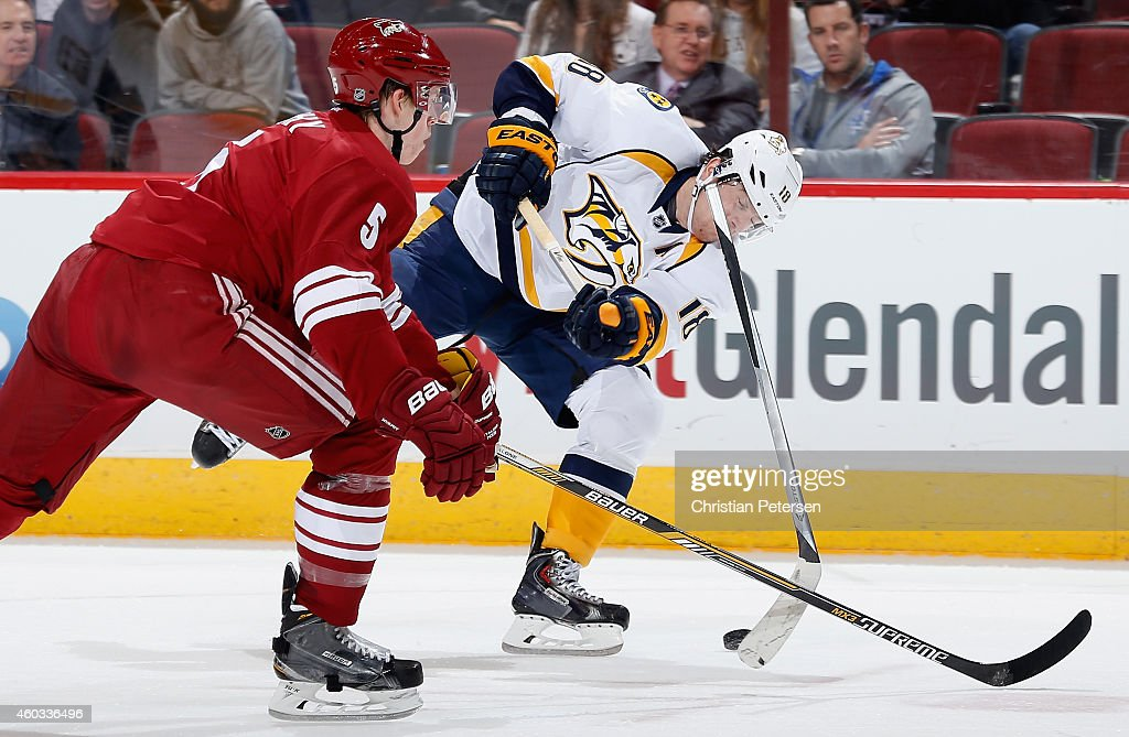 James Neal #18 of the Nashville Predators breaks his stick as he attempts a shot past Connor Murphy #5 of the Arizona Coyotes during the first period of the NHL game at Gila River Arena on December 11, 2014 in Glendale, Arizona.
