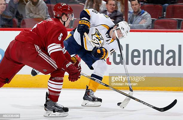 James Neal of the Nashville Predators breaks his stick as he attempts a shot past Connor Murphy of the Arizona Coyotes during the first period of the...