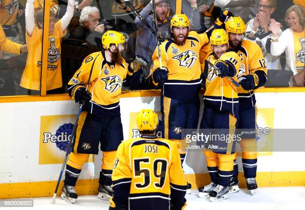 James Neal of the Nashville Predators celebrates with teammates after scoring a second period goal against Matt Murray of the Pittsburgh Penguins in...