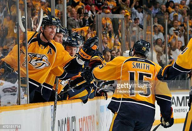 James Neal of the Nashville Predators congratulates teammate Craig Smith on scoring a goal against the Chicago Blackhawks in the second period of...