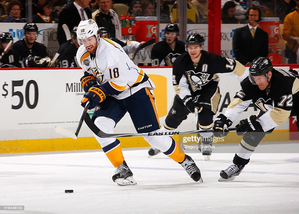 James Neal #18 of the Nashville Predators moves the puck up ice in front of Patric Hornqvist #72 of the Pittsburgh Penguins at Consol Energy Center on March 31, 2016 in Pittsburgh, Pennsylvania.