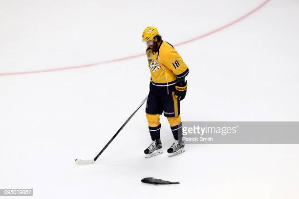 James Neal of the Nashville Predators skates past a catfish against the Pittsburgh Penguins during the third period in Game Six of the 2017 NHL...