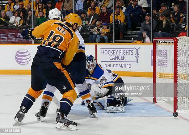 James Neal of the Nashville Predators watches a puck bounce off the post against goalie Jake Allen of the St Louis Blues during the third period at...