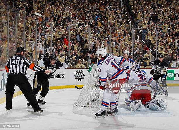 James Neal of the Pittsburgh Penguins celebrates his goal with Evgeni Malkin in front of Daniel Carcillo and Henrik Lundqvist of the New York Rangers...