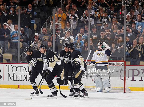 James Neal of the Pittsburgh Penguins celebrates his goal with teammates in front of goalie Marek Mazanec of the Nashville Predators on November 15...