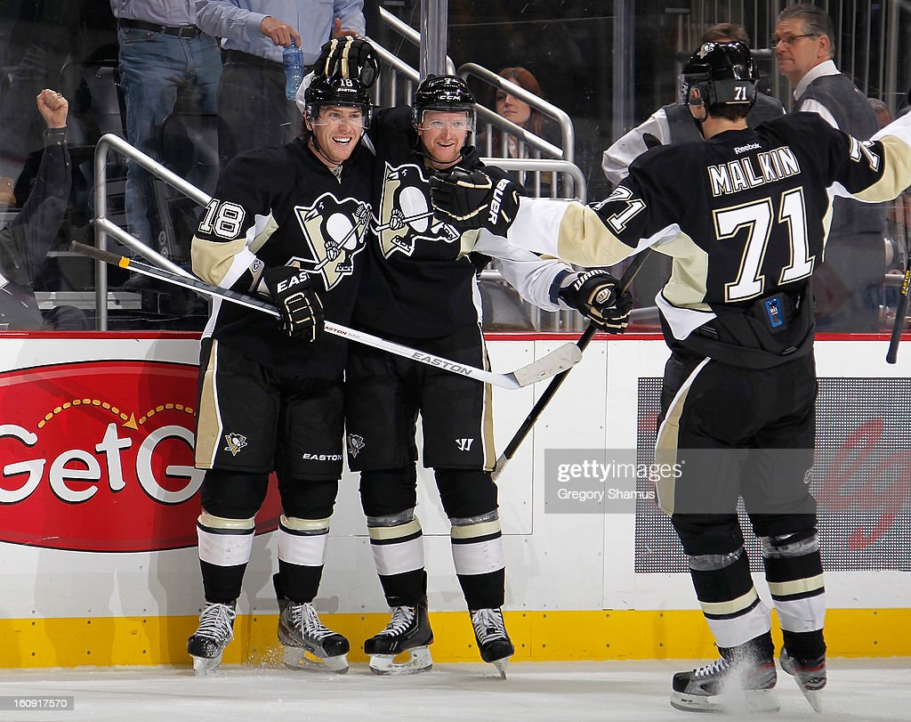 James Neal #18 of the Pittsburgh Penguins celebrates his goal with Paul Martin #7 and Evgeni Malkin #71 during the game against the Washington Capitals on February 7, 2013 at Consol Energy Center in Pittsburgh, Pennsylvania.