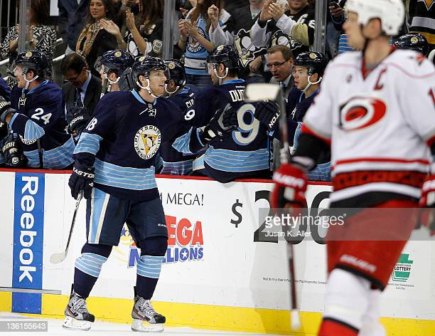 James Neal of the Pittsburgh Penguins celebrates his second period goal against the Carolina Hurricanes during the game at Consol Energy Center on...