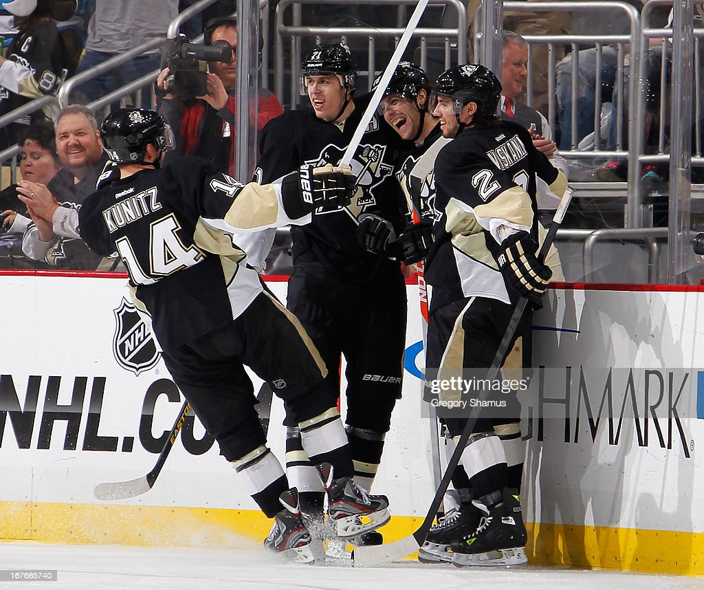James Neal #18 of the Pittsburgh Penguins celebrates his third goal of the game with teammates during the game against the Carolina Hurricanes on April 27, 2013 at Consol Energy Center in Pittsburgh, Pennsylvania.