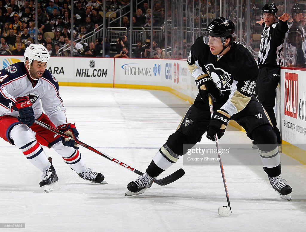 James Neal #18 of the Pittsburgh Penguins moves the puck in front of Derek MacKenzie #24 of the Columbus Blue Jackets in Game Two of the First Round of the 2014 Stanley Cup Playoffs at Consol Energy Center on April 19, 2014 in Pittsburgh, Pennsylvania.