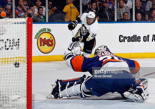 James Neal of the Pittsburgh Penguins scores at 1450 of the first period against Evgeni Nabokov of the New York Islanders in Game Four of the Eastern...