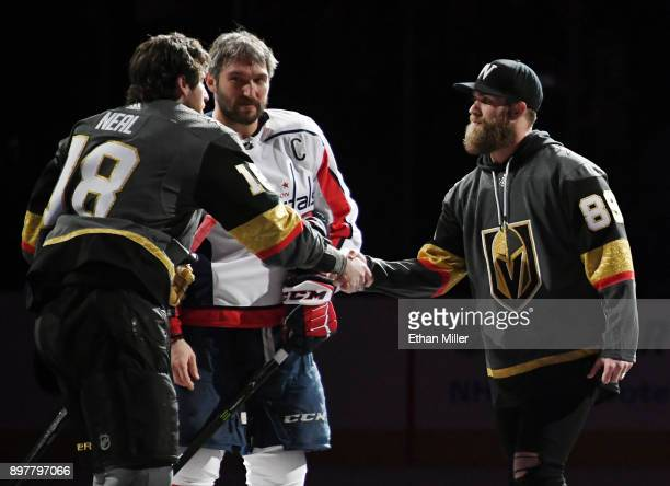 James Neal of the Vegas Golden Knights and Alex Ovechkin of the Washington Capitals shake hands with Washington Nationals outfielder Bryce Harper...
