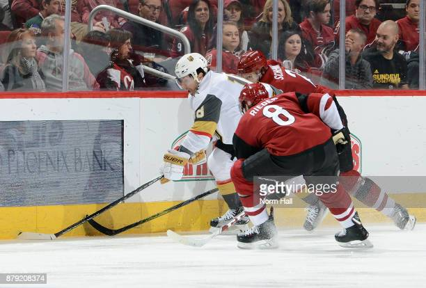 James Neal of the Vegas Golden Knights battles for the puck with Tobias Rieder and Luke Schenn of the Arizona Coyotes during the second period at...