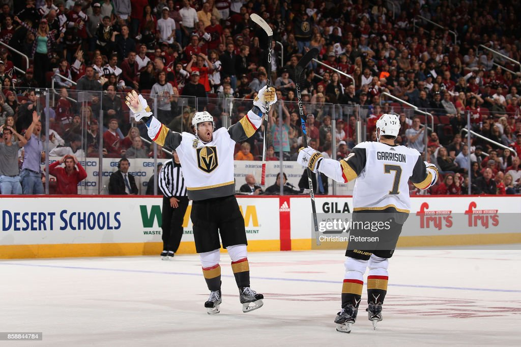 James Neal #18 of the Vegas Golden Knights celebrates alongside Jason Garrison #7 after Neal scored the game winning goal in overtime of the NHL game against the Arizona Coyotes at Gila River Arena on October 7, 2017 in Glendale, Arizona. The Kinights defeated the Coyotes 2-1.