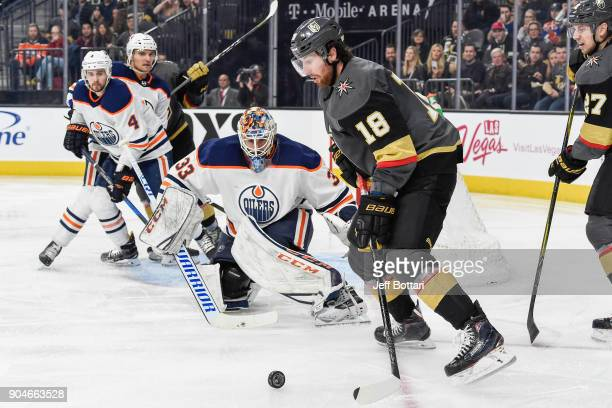 James Neal of the Vegas Golden Knights handles the puck while Cam Talbot of the Edmonton Oilers defends his goal during the game at TMobile Arena on...