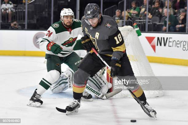 James Neal of the Vegas Golden Knights handles the puck with Matt Dumba of the Minnesota Wild defending during the game at TMobile Arena on March 16...