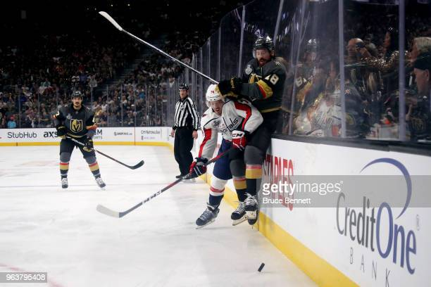 James Neal of the Vegas Golden Knights is checked into the boards by John Carlson of the Washington Capitals during the first period in Game Two of...